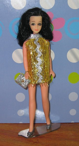 Gold eyelash with silver ric rac + purse